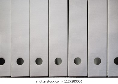 White document archive folders stacked on a shelf with copy space
