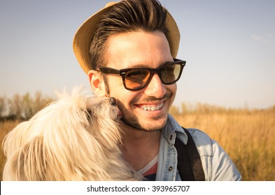 White dog is kissing its owner outdoor - caucasian people - people, animal, nature and lifestyle concept