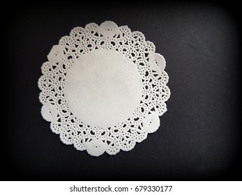 White doily with black background