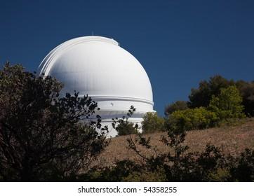 White dome of the Palomar telescope on the peak of Mt Palomar in California
