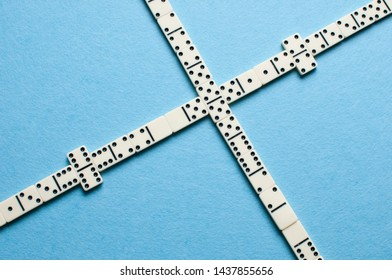 White domino pieces on blue background.