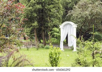 White door at the entrance to the garden