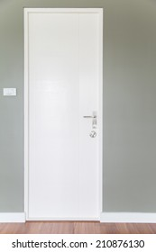 White door and Gray wall
