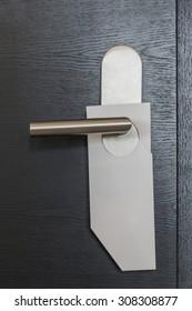 White door hanger without text on modern black door