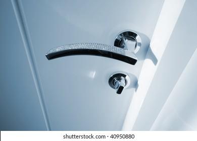 white door with the new metal handle