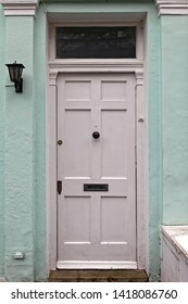 White Door Old Home Entrance With Transom Window