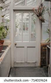 White Door with Others Doors Behind