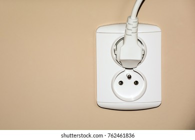 white double electrical socket with plug
