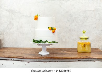 White double layer cake with tangerines