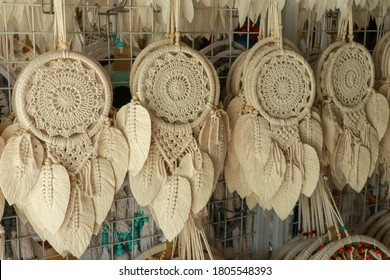 White Dream Catcher with feathers selling at traditional market in Bali, Indonesia