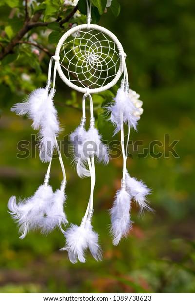 white-dreamcatcher-against-background-gr
