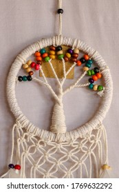 White dreamcatcher - Indian amulet that protects the sleeper from evil spirits and diseases.. The tree - symbol of life. White background.