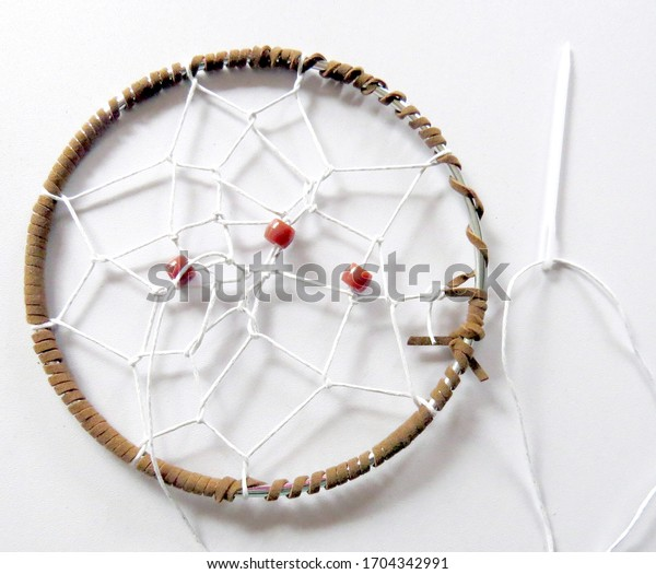 White dreamcatcher with needle and thread on white