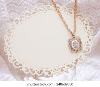 white dress with golden icon for Christening