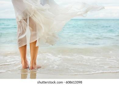 White dress waving on the seaside wind