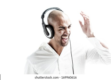 white dressed man having fun with music isolated on white
