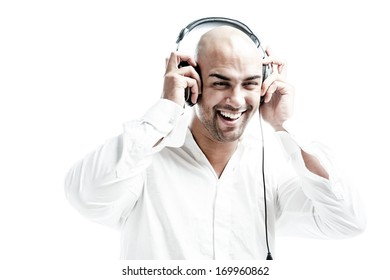 white dressed man smiling while holding his headphones isolated on white