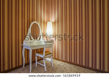 White Dressing Table With Mirror And Lamp On The Background Of Striped  Wallpaper