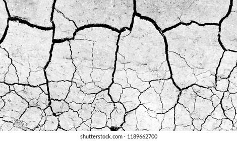 White dried and cracked ground earth background. Closeup of dry fissure ground. Gray crack on earth texture. erosion