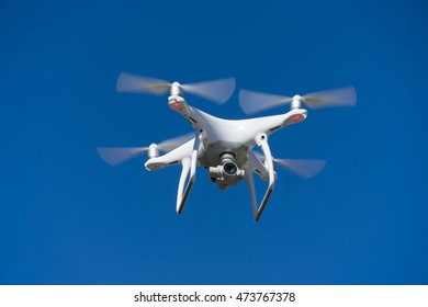 White drone quad copter with summer blue sky
