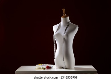 white dummy with measuring tape in tailors studio. sewing workshop, professional dressmakers dummy with measuring tape