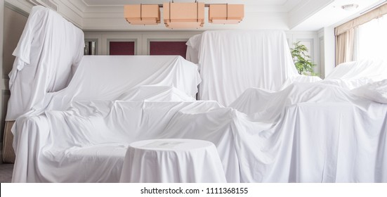 White dust cover cloth covering furnitures in a room