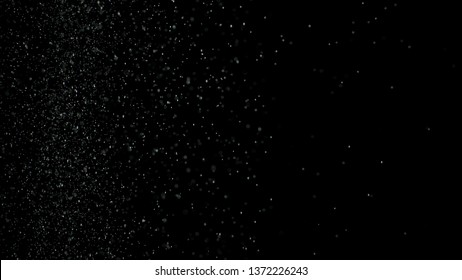 White dust debris exploading on black background, motion powder spray burst in dark texture. Stock footage. Beautiful small particles splashing and falling down.