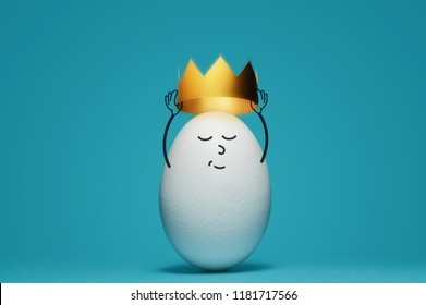 A white egg is dressing a gold crown on blue background. Concept of success.