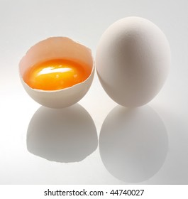 white egg and a half eggs on a white background.