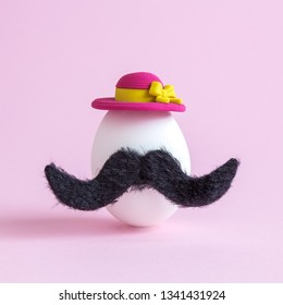 White egg with mustache and sunhat minimal creative easter hipster concept.