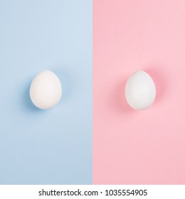 White eggs on blue and pink background. Ð¡oncept gender stereotypes, role of man and woman in society