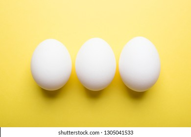 white eggs on a colored background