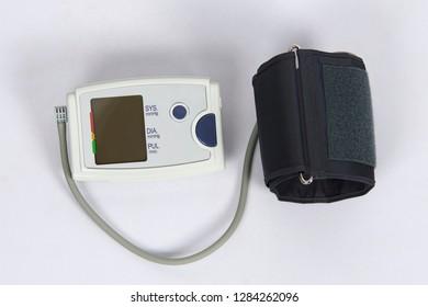 White electric tonometer for measuring blood pressure on white table in studio health care concept.