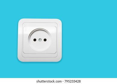 White electricity socket on blue background