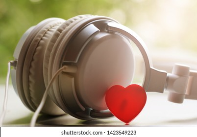 White elegance headfones and red heart, music