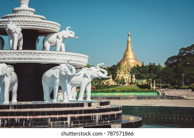 White elephant fountain in Peoples Park, Yangon, Myanmar Burma with the famous Shwedagon Pagoda in that background.