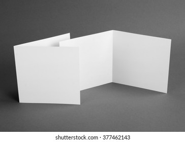 White empty  card on grey to replace your design