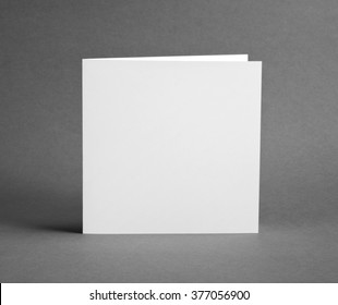 White empty closed card on grey to replace your design