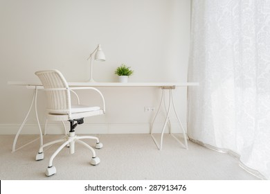 White empty desk in stylish retro interior
