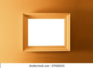 White empty frame on the brown wall. Free copy space.