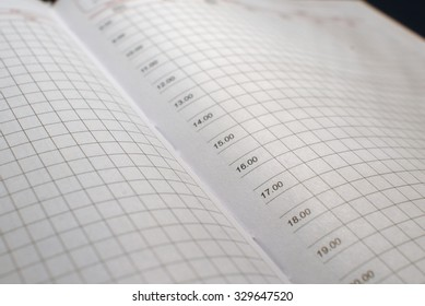 White empty pages with daily time count graph of business diary. Macro technique.