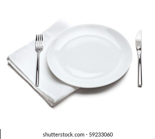 White empty plate with fork and knife
