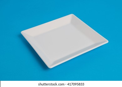 White empty plate on blue background