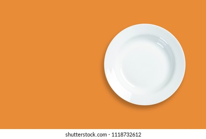 white empty plate on color background