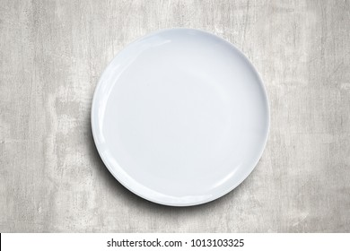 white Empty plate on concrete texture background. Top view with copy space