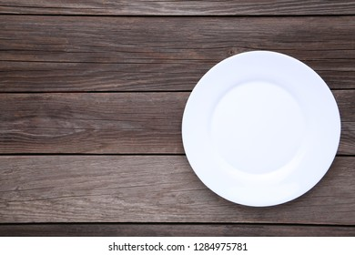 White empty plate on grey background, close up