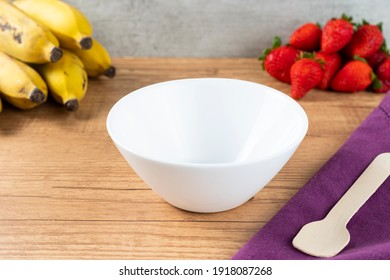 white empty pot bowl to put fruits or ice cream on a wooden table background. copy space