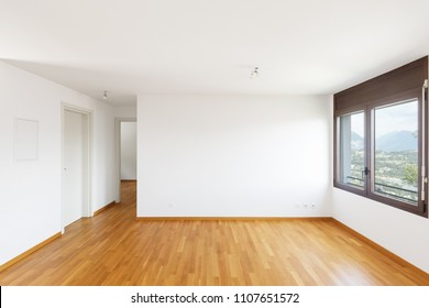 White empty room with parquet in modern apartment. Large windows overlooking the lake and no one inside