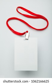 White empty staff identity mockup with red lanyard. Name tag, ID card.