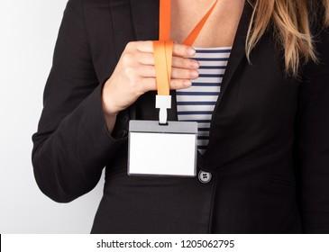 White empty staff identity mockup with orange lanyard. Woman wear blank